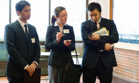 International students discuss opportunities with an employer representative at last spring's Career Fair.