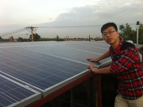 Yawei Wei inspects the solar panels he and his family installed on his cousin's roof in the rural Chinese community of Zao Yuan.
