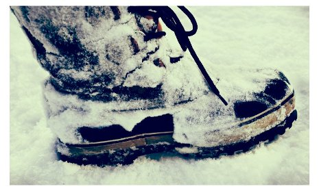 Winter boot in the snow.