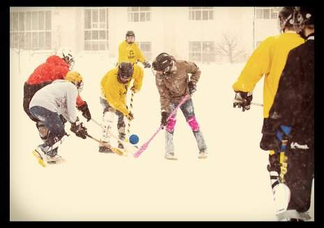 Students playing broomball.