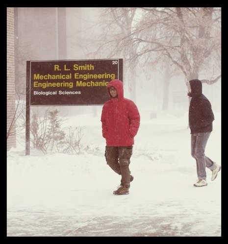 Students walking through campus in the winter.