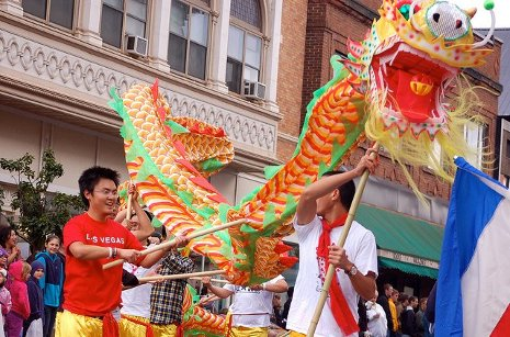 Chinese students and their dragon march in the Parade of Nations.