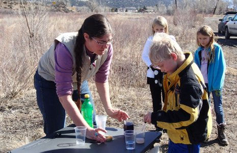 Rhianna Williams, a Michigan Tech master's degree student and OSM/VISTA volunteer, teaches children to test water quality in a Riverwatch program in Colorado.