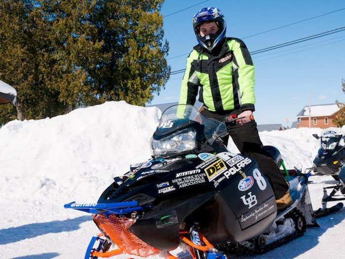 Driver Noor Jariri and the SUNY Buffalo sled, which completed the 2014 SAE Clean Snowmobile Challenge Endurance Run.