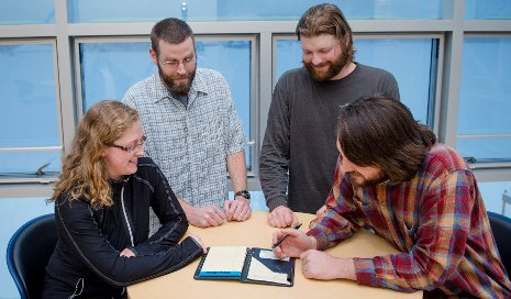 Graduate students Lindsey Watch, Cameron Goble, Tony Mathys and Luke Bowman are learning to communicate science to school children and the public.