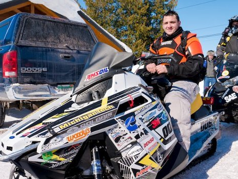 Driver William Gielda and the Michigan Technological University sled, which completed the 2014 SAE Clean Snowmobile Challenge Endurance Run.