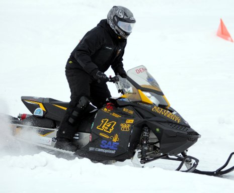 The University of Kettering's four-stroke sled took first place at the 2014 SAE Clean Snowobile Challenge, held at Michigan Tech.
