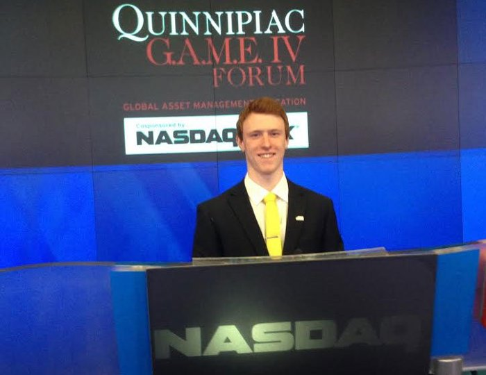 Heath Johnson at the NASDAQ closing with the winning APMP Gold Team.