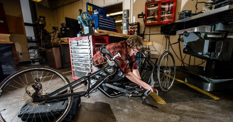 Michigan Tech Senior Design student works on one of the team's handcycle prototypes.