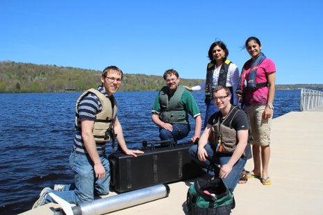 Nina Mahmoudian, second from right, and her team of student researchers on the Michigan Tech waterfront, prepare to launch their underwater drone, ROUGHIE, in Portage Lake.
