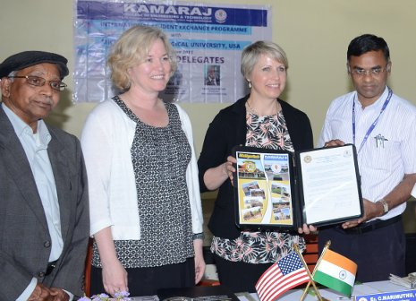 From left, Gopal Jayaraman, Mary Raber and Lorelle Meadows from Michigan Tech, pose with O.M.S.P.C. Marimuthu of Kamaraj College of Engineering and Technology at the signing of a MOU between the two schools.