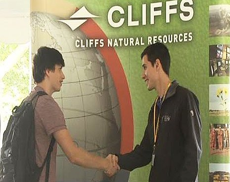 A Michigan Tech student meets with a representative of Cliffs Natural Resources during Steel Days in 2014.