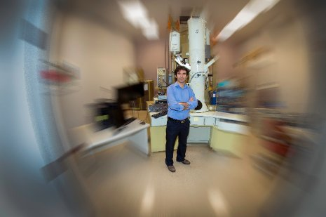 "Durdu Guney stands in the lab where he and his team work on a metamaterial-based ""perfect lens""."