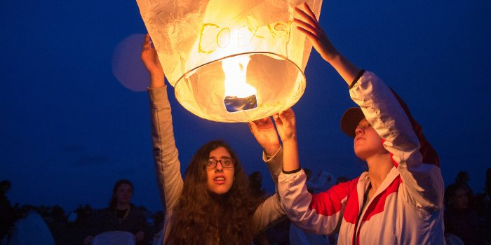 Yasmeen Jassim, left, a student from Bahrain, launches a sky lantern during the Women In Engineering program at Michigan Technological University.