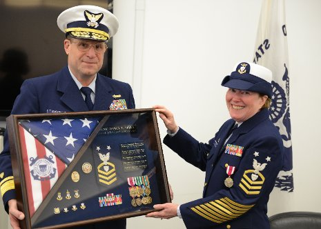 Nancy, right, Admiral Joseph Servidio are seen at her retirement from the Coast Guard Reserve.