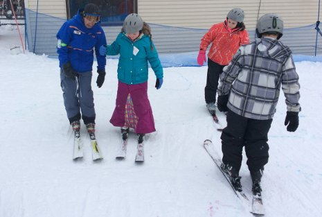 Children from the Keweenaw Bay Ojibwa Community College Youth STEM Academy learn to ski on Mont Ripley.