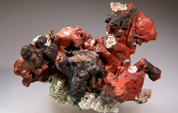 A copper specimen from the Phoenix Mine in Keweenaw County. The red color comes from a thin coating of the mineral cuprite.  Photo:  Debra Wilson