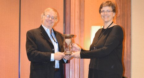 Greg McKennon, past president of the Society of Rheology, presents Michigan Technological University Chemical Engineering Professor Faith Morrison with the Distinguished Service Award. The presentation was made last month in Baltimore.