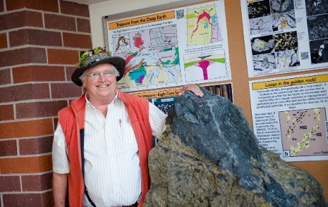 Professor Emeritus Bill Rose with the 3.5 ton nickel-copper sulfide boulder from the Eagle Mine.