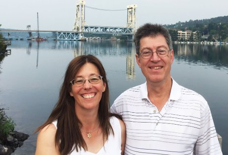 Liza and Donn Schneider are seen on the Houghton waterfront. The couple, from Green Bay, have established an endowed professorship and postdoctoral fellowship support in Michigan Tech's Department of Computer Science.