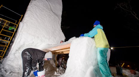 Michigan Tech student groups are crafting enormous snow statues for Winter Carnival.
