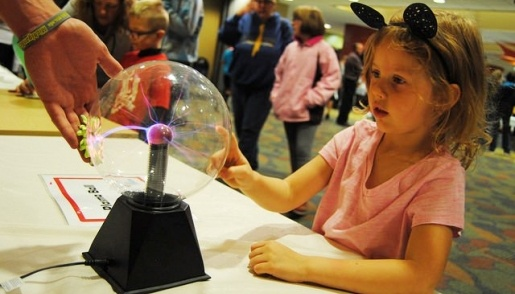 Mind Trekkers student touching an electric ball.
