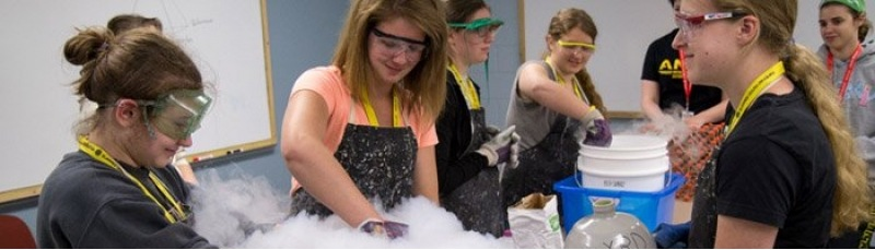 Summer Youth Programs students working on an experiment involving dry ice.