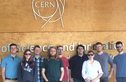 Physics in a group image at CERN sign