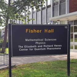 Exterior of Fisher Hall with students, location of the Elizabeth and Richard Henes Center for Quantum Phenomena