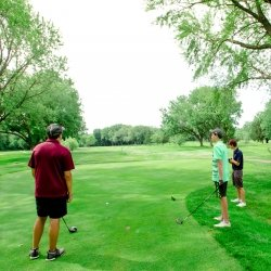 People golfing at the Portage Lake Golf Course