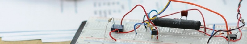 circuit board with red and blue wires.