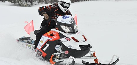A rider on a snowmobile.