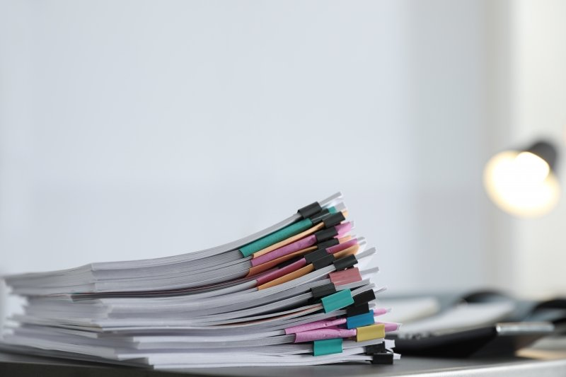 Stack of paper with binder clips