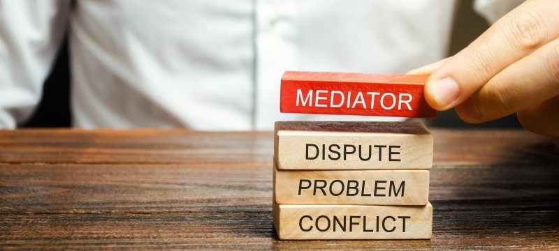 Person stacking mediate, dispute, problem, conflict blocks
