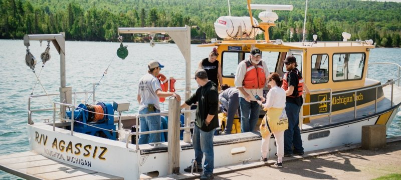 Students boarding a research vessel