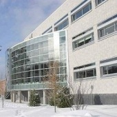 The outside of the J Robert Van Pelt Library in the winter