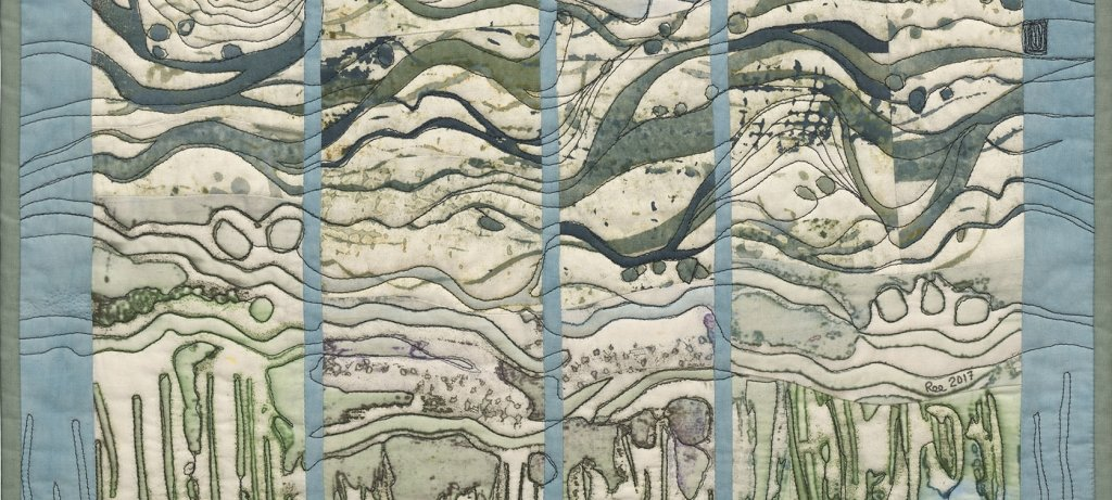 Quilt with abstract wave, rock, and plant images