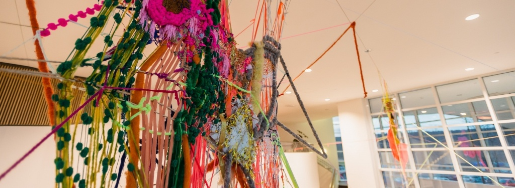 A weaving installation by Sarah Hewitt in the Samuel and Grace Horner Lobby