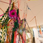 Yarn and fabric woven suspended in an installation in the Rozsa lobby