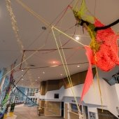 Another view of a yarn and fabric installation from the ceiling of the Rozsa lobby.