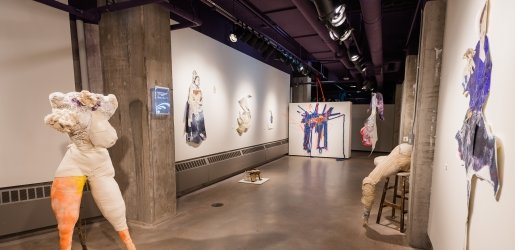 Inside the Rozsa Gallery during an exhibition, framed art on the walls with no floor displays