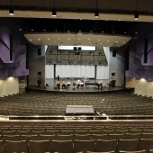 Inside the Performance Hall, looking at the stage from the back tier