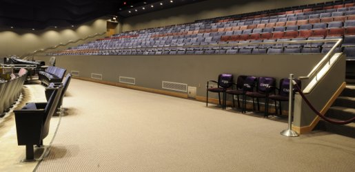 Inside the Performance Hall, showing the view of the middle aisle with usher seating and sound board