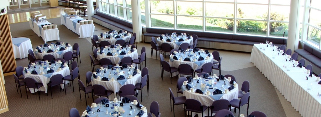 Horner Lobby set up for a wedding receiption with sitting tables, chairs, place settings, and buffet tables.