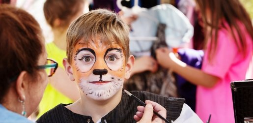 Child with tiger facepaint