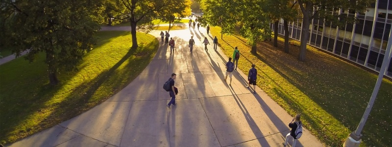 Aerial of campus mall with students walking by Fisher Hall