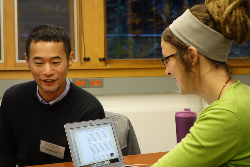 Student and faculty member seated at a table.