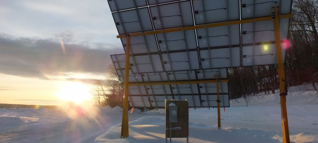 Solar panel in winter with sun shining
