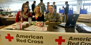 Blood drive volunteers sitting a check-in table