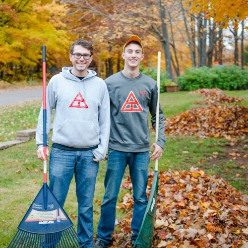 Two Michigan Tech students volunteer raking